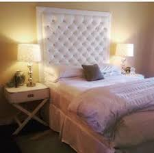 white faux leather crystal button tufted headboard with double