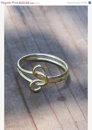 what does a knot ring this simple infinity knot ring is done in solid bright