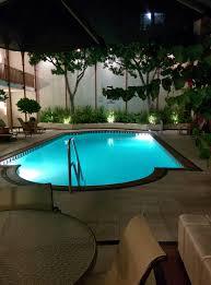 swimming pool at night free stock photo