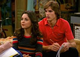 ashton kutcher shares picture of wearing that 70s show shirt