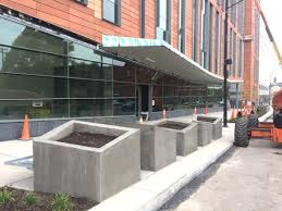 custom site specific designs for planters and benches at main and