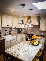 french kitchen farmhouse sink cream cabinets mini chandelier