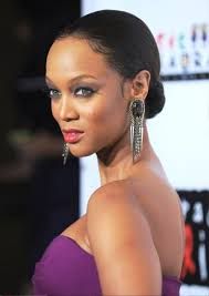 pictures of tyra banks bun updo for thin hair