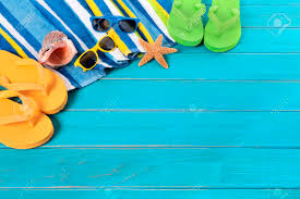 seashell flip flops with striped towel sunglasses flip flops seashell