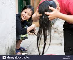 pretty verry young boys washing hairs two young girls wash their hair by the railway track that runs