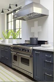 beautiful splash of recent color over a timeless grey kitchen