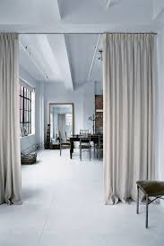 Ceiling Track Curtains Divy It Up Divide Your Apartment With Wall Dividers