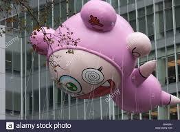 the takashi murakami helium filled balloon floats overhead