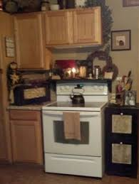 primitive decorating ideas for kitchen shutter shelf i just put my stove home decorating