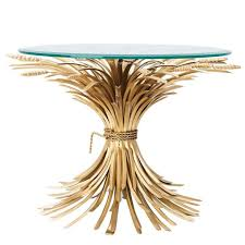 wheat sheaf side table in antique gold finish with glass top for