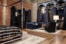 Bedroom Curtain Design And Exposed by An Open Urban Loft Features Exposed Brick And Hardwood Floors