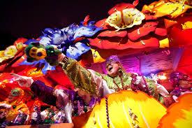 mardi gras trinkets mardi gras parade honors new orleans tricentennial