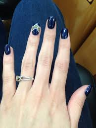 acrylic nails with a navy blue that has red speckles in it with a
