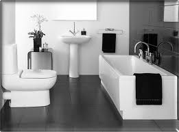 bathroom black and white rectangle white bathtub and white latrine on black tile floor