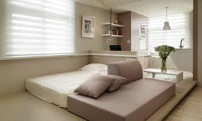 studio apartment design ideas 400 square feet red pillow cream studio white stool mounted fur rug ceiling round apartment studio design