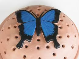 mosquito coil holder with built in stand ulysses butterfly design