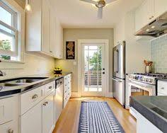 the layout of this galley style kitchen combines elegance with