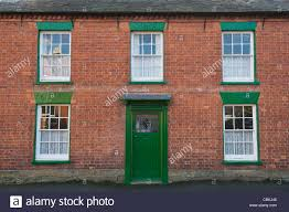 brick house front door detached period red brick house with sash windows and green