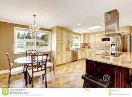 kitchen interior with dining table set and island stock photo