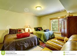 simple guest bedroom in cabin style home with two twin beds stock