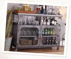 world market bar cabinet 6 tips for a hip home bar via cost plus world market cheers diy