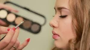 makeup artist sketchbook beautiful of beautiful girl looks at his sketchbook stock