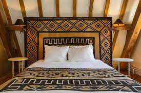 bedroom arfican bedroom in white comfort bed and brown arfican comfort bed and brown arfican pattern fabric headboard also twin round white bedside tables and exposed wood ceiling african bedroom decorating ideas to