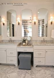 white bathroom with gold vanity mirrors transitional arched mirror