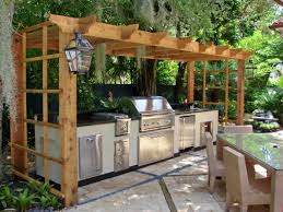 a backyard shady kitchen in the garden with an outdoor dining area