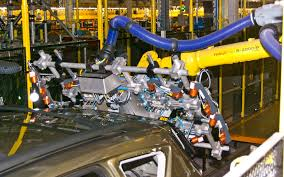 bmw factory robots robots with laser eyes help manufacture 2013 ford escape