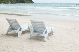 white bench and table on a beach by the sea a relaxing holiday