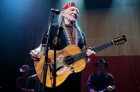virginia governor poses for picture with willie nelson and his