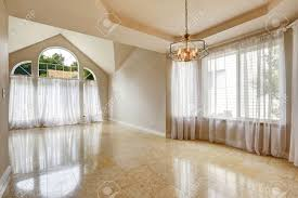 emtpy house interior with shiny marble tile floor hight vaulted