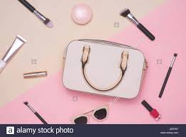 Pink Flat Color Flat Lay Of Female Fashion Accessories And White Handbag On Pastel