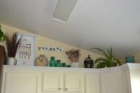Above Cabinet Kitchen Decor Paint Me Shabby Filling The Awkward Space Above Kitchen Cabinets