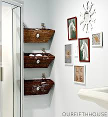 wonderful three rattan towel storage basket hanging on white wall