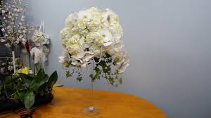 how to make a tall arrangement in martini vase with orchids and