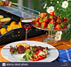 Backyard Grill Com by Skewers In Plate With Wine Glass And Strawberries At The Backyard