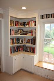 Build Corner Bookcase Wrap Around Shelves With Cabinet Doors And That Window Seat Needs