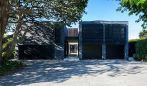 entrance driveway garages modern house in auckland new zealand