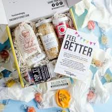 feel better care package welcome home housewarming care package in box the confetti post