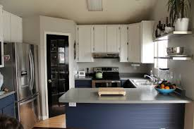 gray kitchen walls with white cabinets monsterlune