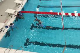 high tech pool designers give nycha children free swimming lessons