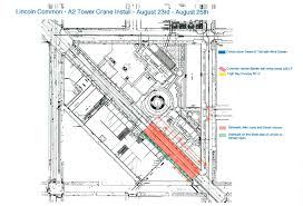 construction crane for lincoln common development rises over