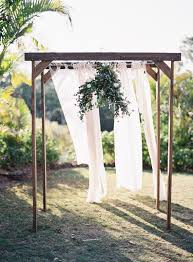 ceremony set up using white timber arbour draping and bistro