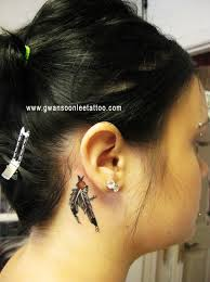 small feathers tattoo behind ear photo 2 photo pictures and