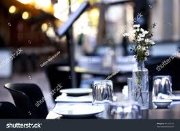 pavement cafe table casual setting focus stock photo 64134232