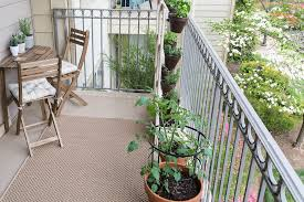 balcony garden vegetables complete with wooden folding patio table