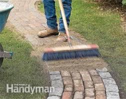 build a brick pathway in the garden family handyman