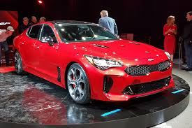 porsche stinger price kia turns up the heat new stinger fastback unveiled in detroit by